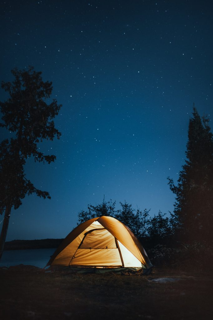 a tent and a starry sky