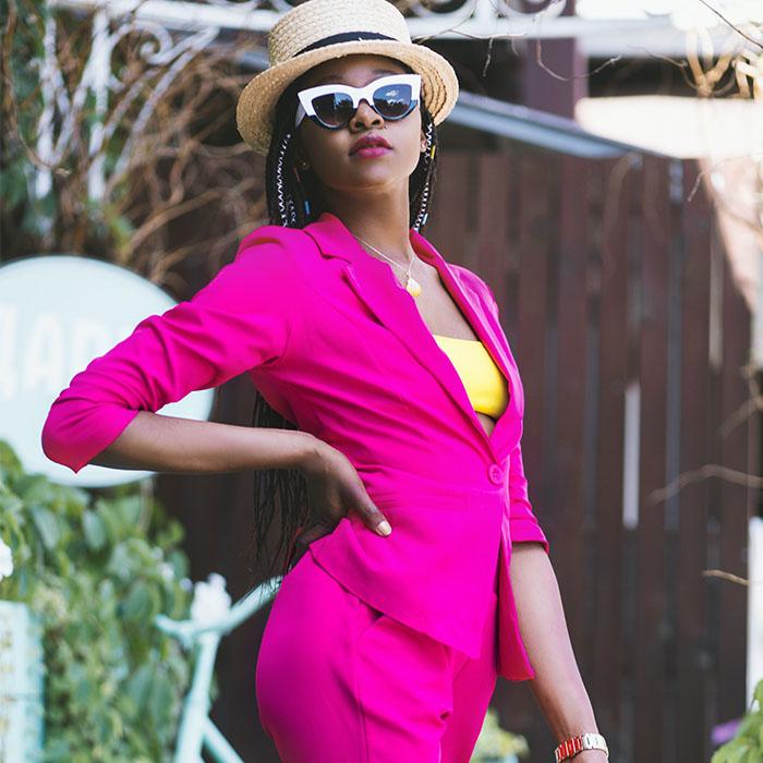 woman with bright pink blazer