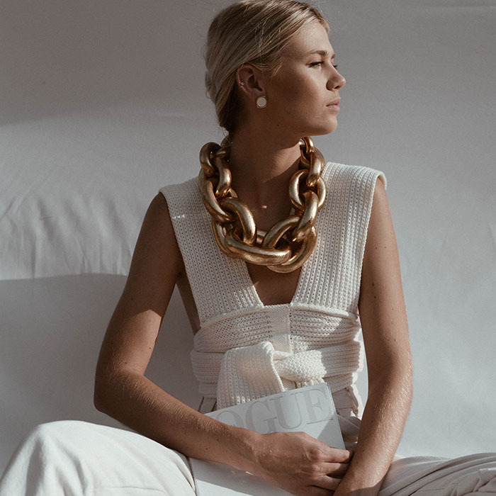 woman with chunky gold necklace