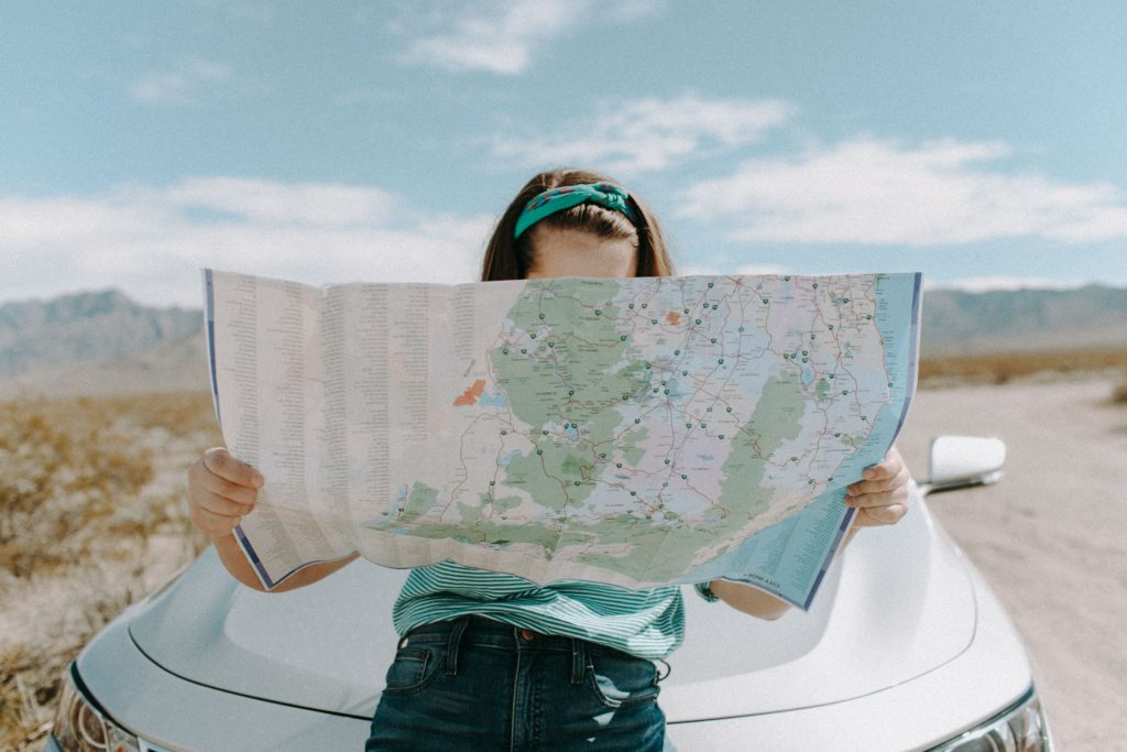 girl with a map on road trip
