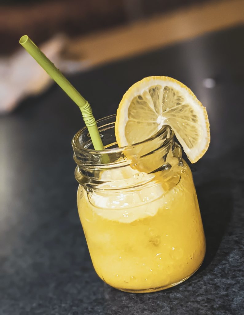 glass of lemonade with straw