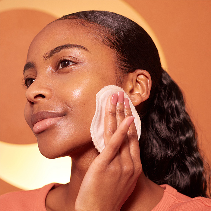 a model cleansing her face