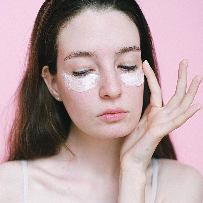 model applying eye cream