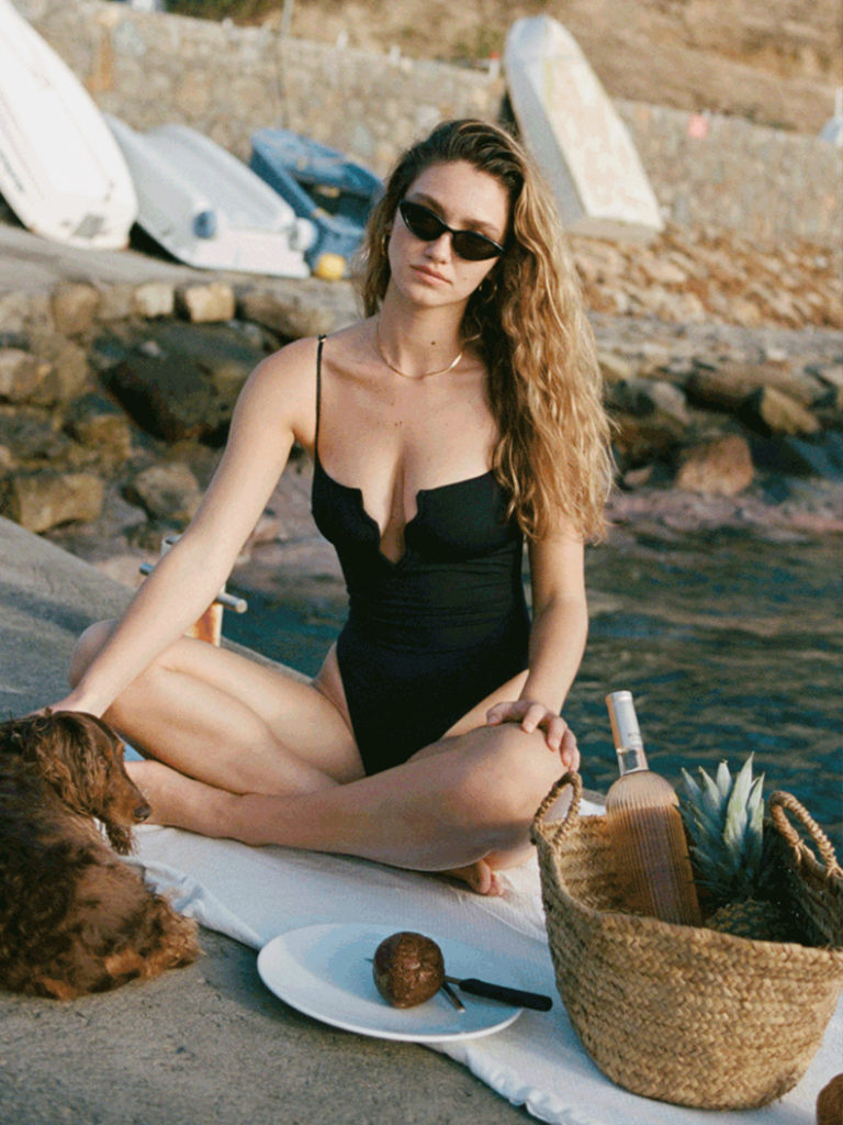 model by the sea in swimsuit