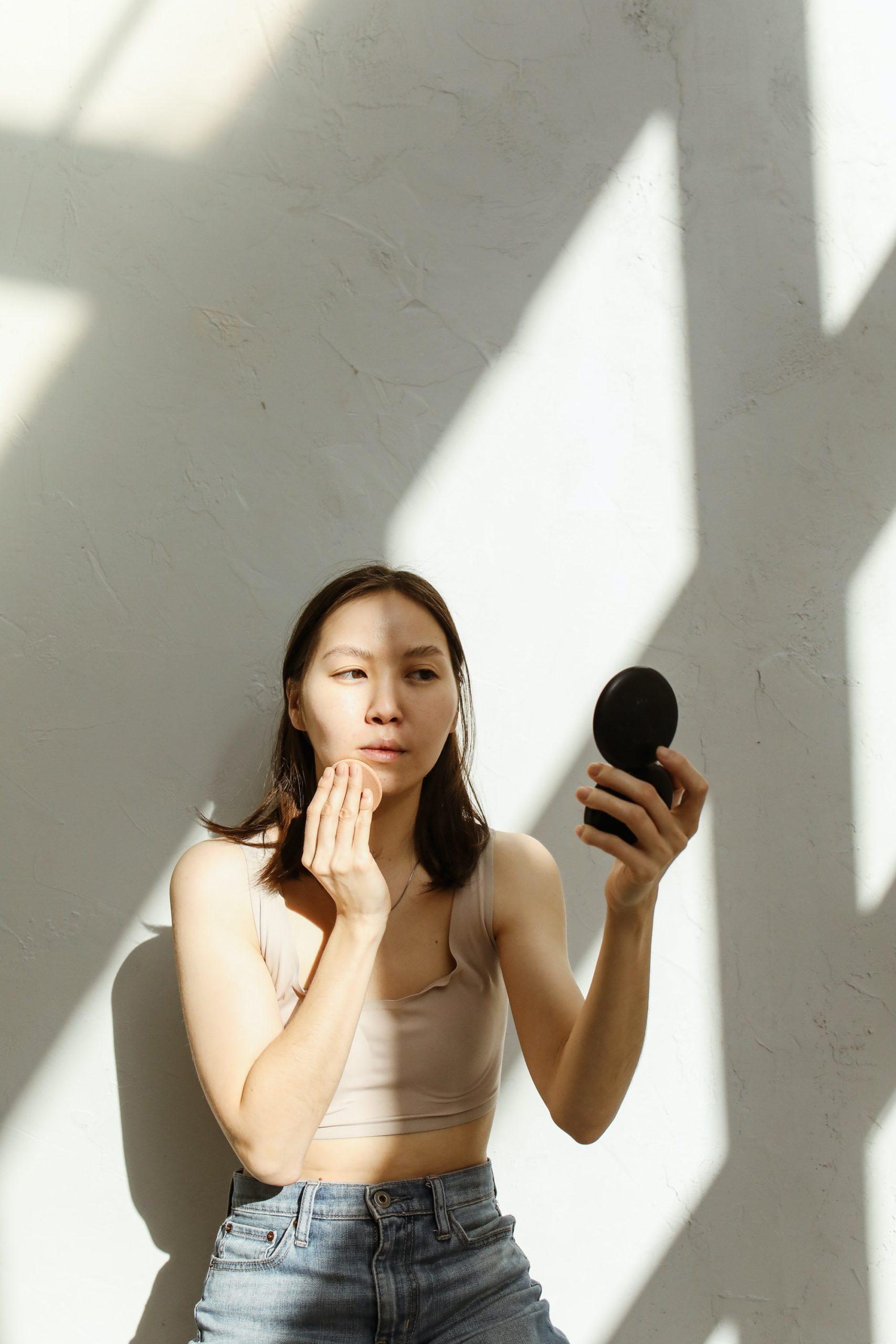 a woman applying makeup