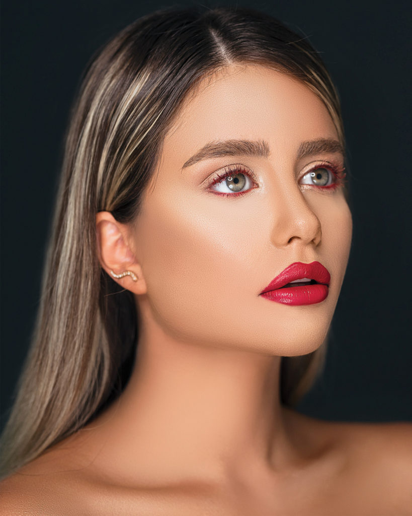 model with subtle red eyeliner